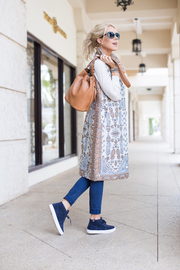 Tory Burch Holiday Sale 50% off sale 60% of sale printed longline vest soft sneakers retro shades bucket bag The Supper Model